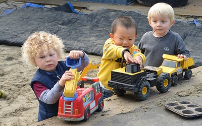 children at daycare playing in sandpit