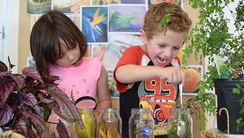 girl and boy experimenting at preschool