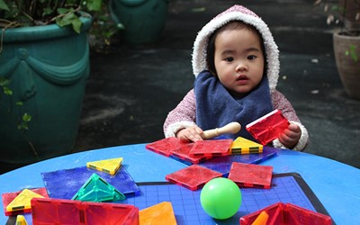 baby playing with blocks at daycare