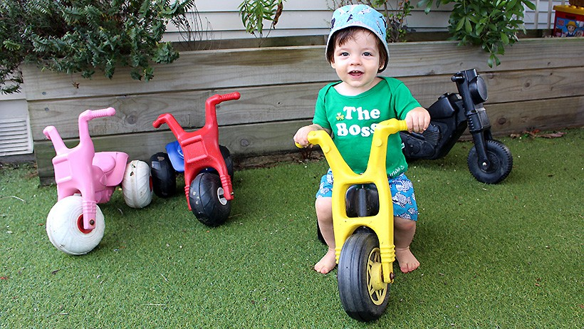 boy on trike at childcare