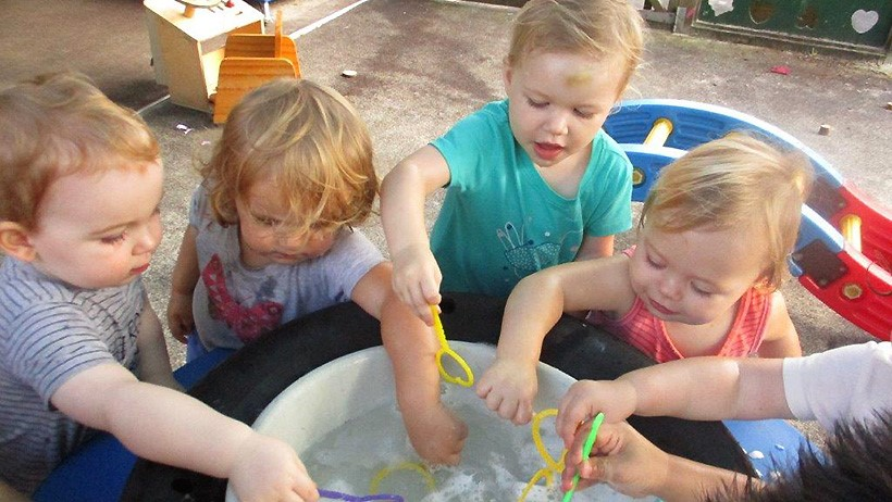 children playing with bubbles at daycare
