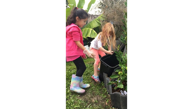 children in garden for sustainability at daycare