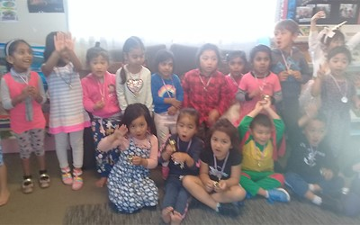Learning Adventures Mangere East daycare children showing their medals