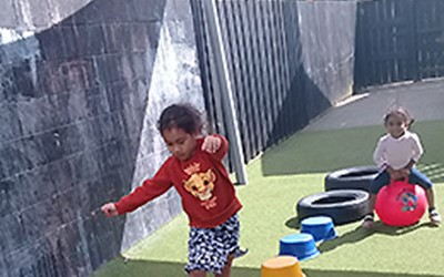 Children playing with balls at Learning Adventures Mangere East daycare
